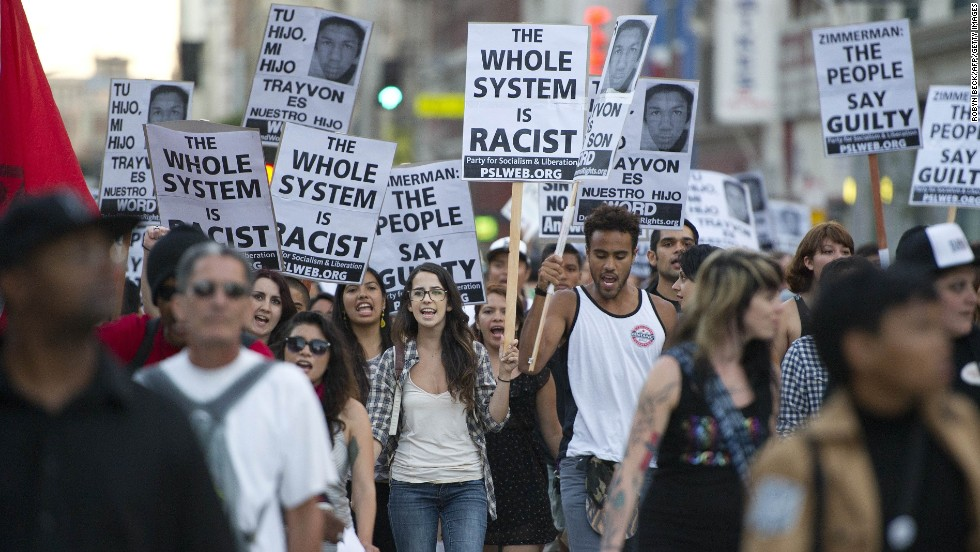 Protesters march through the streets of downtown Los Angeles, on Tuesday, July 16, during a demonstration of the George Zimmerman trial.