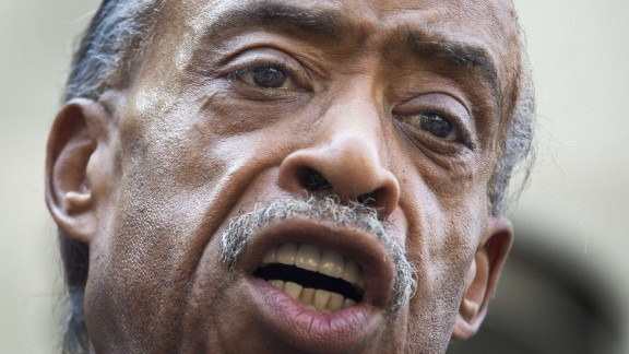 The Rev. Al Sharpton calls for a full federal investigation of the Martin killing, saying mere remarks by President Barack Obama and others weren