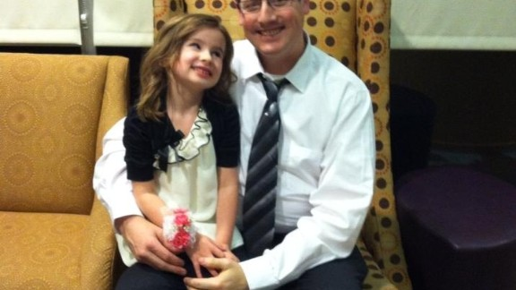 "Chase Roper, a comedy writer and full-time dad of four kids in Puyallup, Washington, poses with his daughter at a father-daughter dance. ""I realized that the way I provide for my family now is by being dad. Once I embraced that, I found my groove."" (Read his story.)"