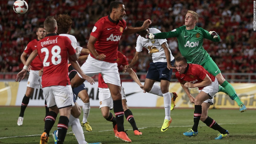 Players scramble as Manchester United's Ben Amos punches the ball away during a friendly between Singha All Star XI and Manchester United in Bangkok, Thailand. Alex Buttner picked up a hamstring strain in the friendly.