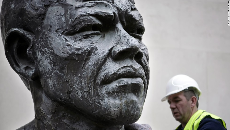 <strong>ENGLAND: </strong>A six-foot bronze sculpture of Mandela is lifted onto a platform in front of the Royal Festival Hall in central London. Cast in bronze, the sculpture was originally unveiled in 1985, five years before Mandela's release from prison.