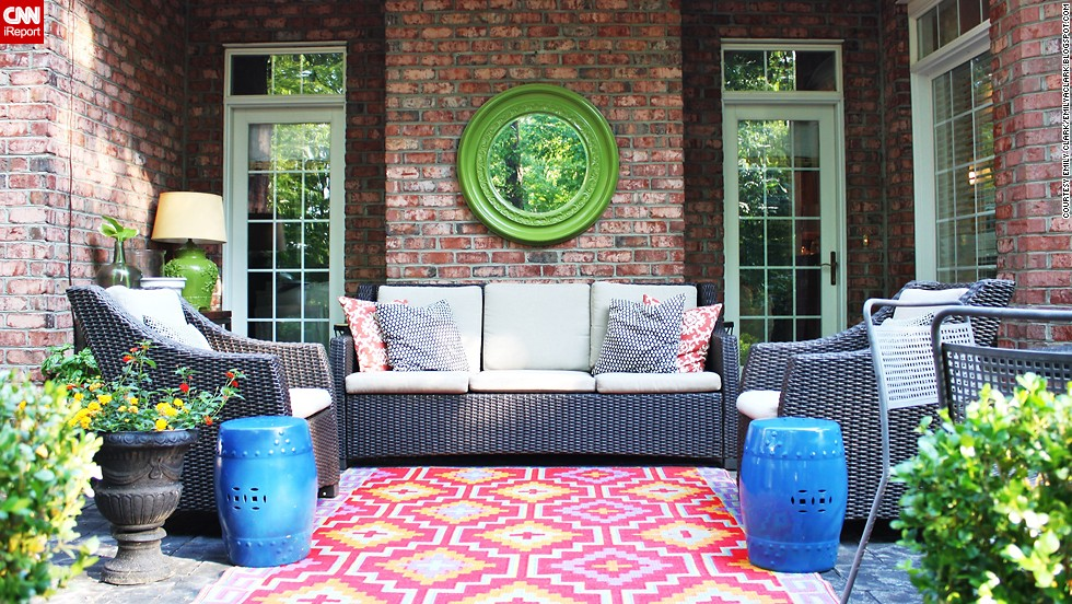 "<a href=""http://ireport.cnn.com/docs/DOC-1005402"">Emily Clark</a> livened up her patio with a colorful outdoor rug and spray painting a mirror and two garden stools."