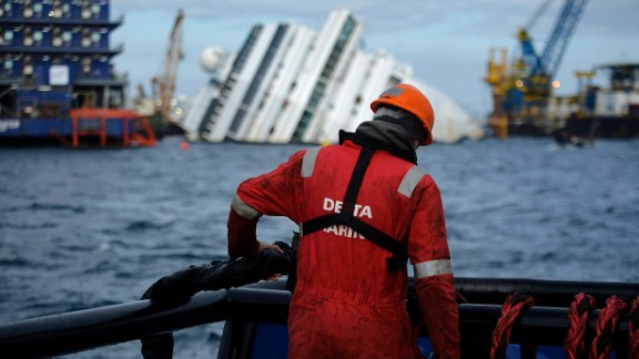 A man works in front of the shipwreck on January 12, 2013.