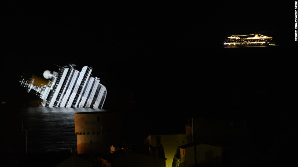The Costa Serena, the sister ship of the wrecked Costa Concordia, passes by on January 18, 2012.