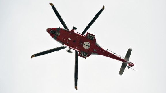 An Italian coast guard helicopter flies over Giglio