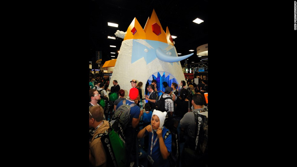 "Fans wait to walk through a giant display of Ice King character from ""Adventure Time"" at the Cartoon Network booth during the Preview Night event."