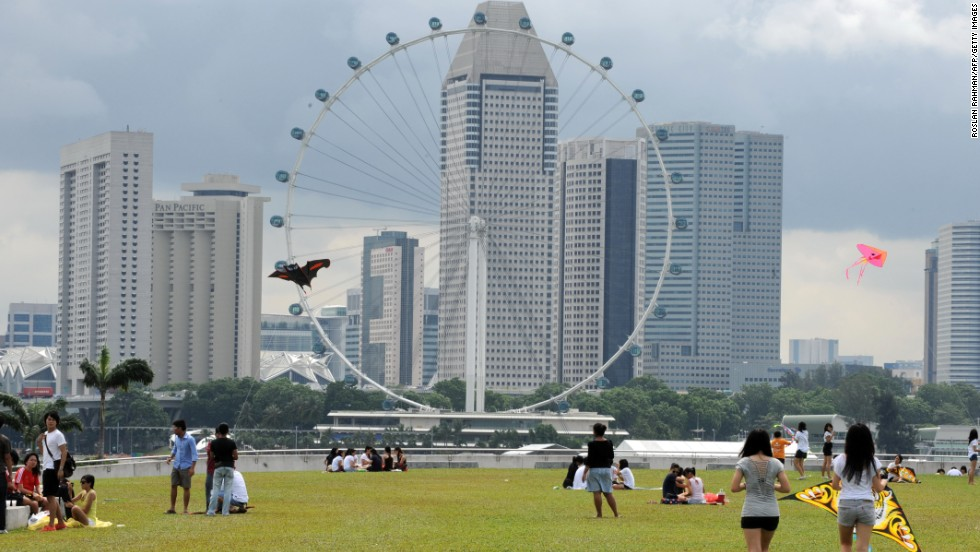 The Singapore Flyer stands tall at a height of 541 feet. Each car holds 28 people and takes 30 minutes to take in all the scenery. The wheel was assessed by feng shui experts and now spins clockwise.