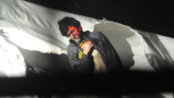 The backlash over Rolling Stone's cover photo of Boston Marathon bombing suspect Dzhokhar Tsarnaev led to the release of new photos of his capture. The images, released by Police Sgt. Sean Murphy on July 18, 2013, show Tsarnaev as he emerges from the boat where he hid in Watertown, Massachusetts.
