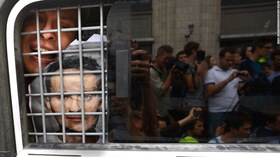 "JULY 19 - MOSCOW, RUSSIA: A supporter of convicted opposition leader Alexei Navalny is detained by police during a demonstration in Moscow. Navalny, one of president Vladimir Putin's most outspoken critics, was found <a href=""http://cnn.com/2013/07/19/world/europe/russia-navalny-case/index.html?hpt=hp_t1"">guilty of misappropriating funds</a>. The EU called the trial a sham."