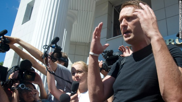 Russia's top opposition leader Alexei Navalny speaks after leaving the courtroom in Kirov on July 19, 2013. A Russian court on Friday unexpectedly freed protest leader Alexei Navalny pending his appeal against a five-year sentence on embezzlement charges, after his jailing prompted thousands to take to the streets in protest. The judge in the northern city of Kirov ruled that keeping President Vladimir Putin's top opponent in custody would deprive him of his right to stand in mayoral elections in Moscow on September 8. AFP PHOTO/SERGEI BROVKO (Photo credit should read SERGEI BROVKO/AFP/Getty Images)