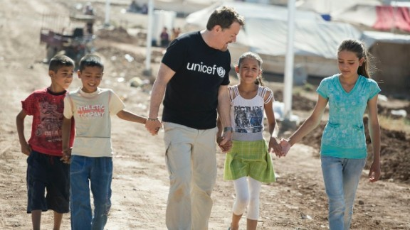 UNICEF UK Ambassador Eddie Izzard with 10-year-old Muhammed and his family in Domiz Syrian refugee camp, northern Iraq.