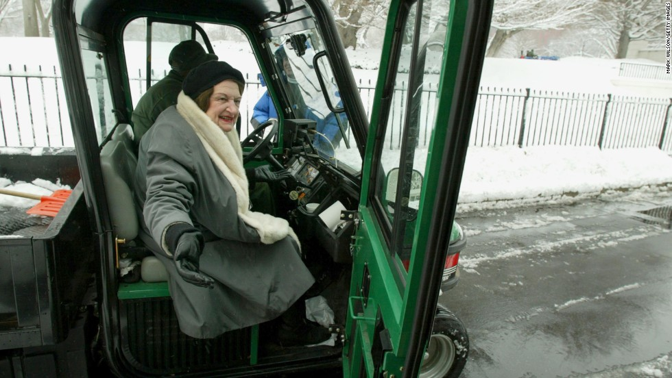 Thomas gets out of a utility vehicle after catching a ride from the front gate to the briefing room at the White House on February 7, 2003.