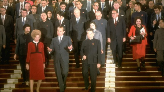 Thomas, right, walks behind President Richard Nixon and a large group in China on February 1, 1972.