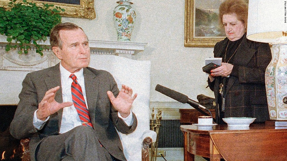 Thomas takes notes as President George H.W. Bush speaks with reporters in Washington on January 21, 1989.