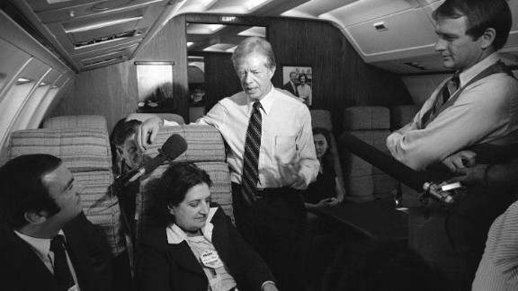 President Jimmy Carter and press secretary Jody Powell, right, chat with reporters, including Thomas, on Air Force One on October 20, 1979.