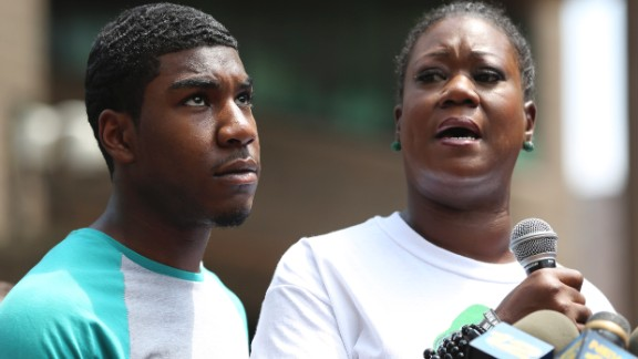 Sybrina Fulton, mother of Trayvon Martin, is joined by her son Jahvaris Fulton as she speaks to the crowd during a rally in New York City, Saturday, July 20. A jury in Florida acquitted Zimmerman of all charges related to the shooting death of Trayvon Martin. View photos of key moments from the trial.