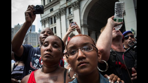 """Protesters attend a rally in support of Trayvon Martin, in New York  on July 20. The Rev. Al Sharpton's National Action Network organized the """"'Justice for Trayvon' 100 city vigil"""" which called supporters to gather in front of federal buildings around the country on July 20, as a continued protest against the George Zimmerman verdict."""