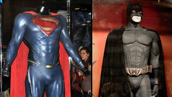 """The Superman costume from """"Man of Steel"""" and the Batman costume from """"Batman Begins"""" are displayed in cases"""