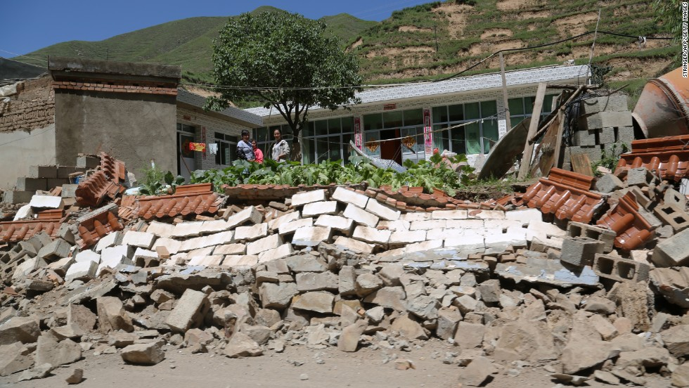 The quake leaves a wall collapsed in Hetuo township in Dingxi on July 22. Chinese President Xi Jinping has urged crews to make the rescue of survivors a priority, according to state broadcaster CCTV.
