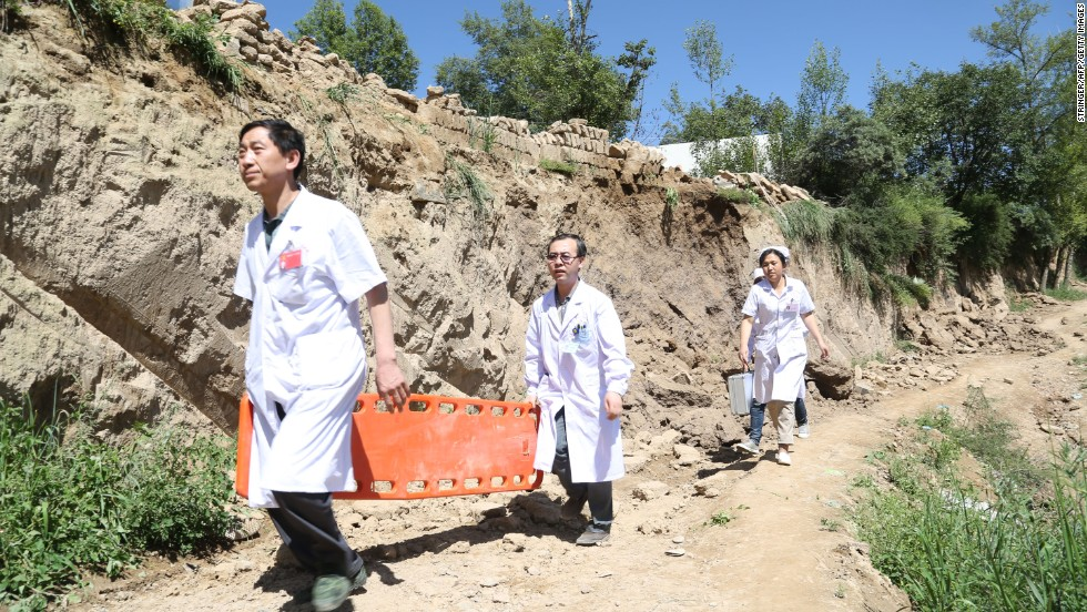 Rescuers arrive at Lalu village in Minxian on July 22.