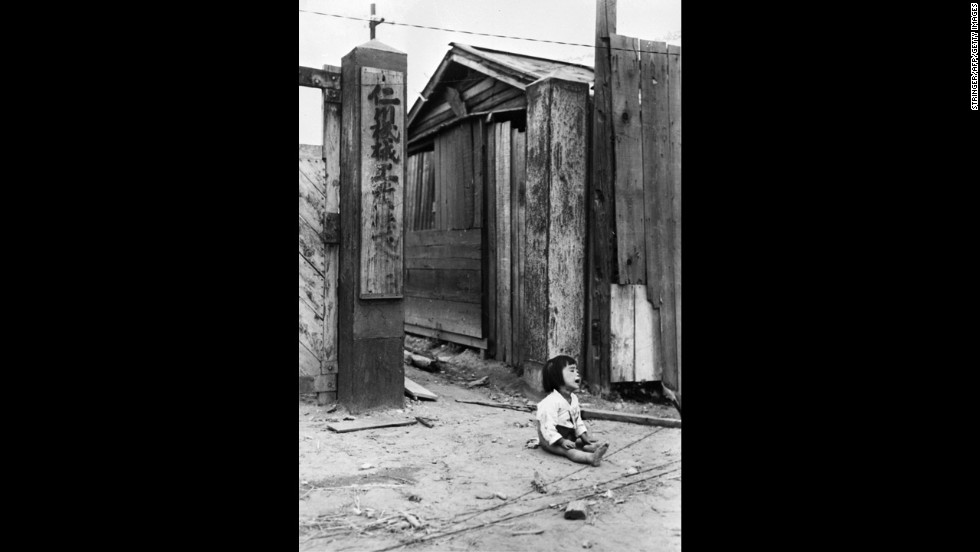 An abandoned girl cries in the streets of Incheon, South Korea, in September 1950.
