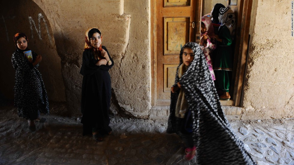 Girls leave a religious school in Herat, Afghanistan, on July 22.