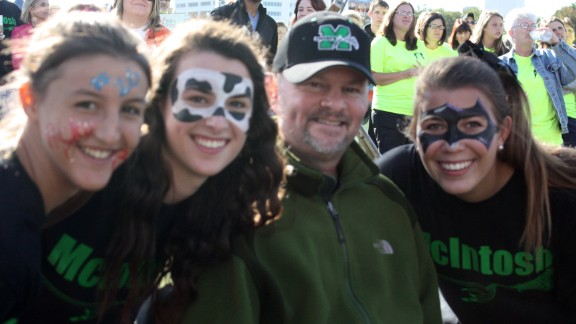 The girls often paint their faces for fundraising events, to  show their spirit and to keep Coach Mickey smiling.