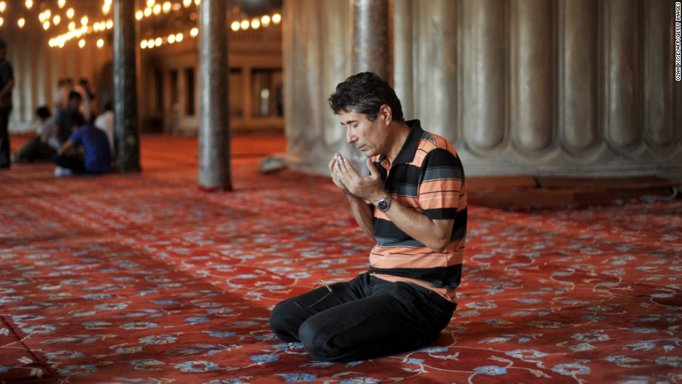 A man prays after breaking his fast on July 22 inside the Blue Mosque in Istanbul, Turkey.