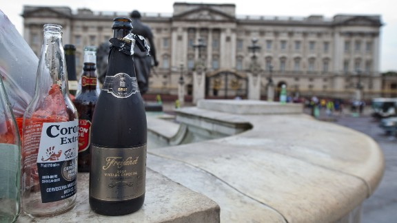 Empty bottles of alcohol sit outside Buckingham Palace in London on July 23.