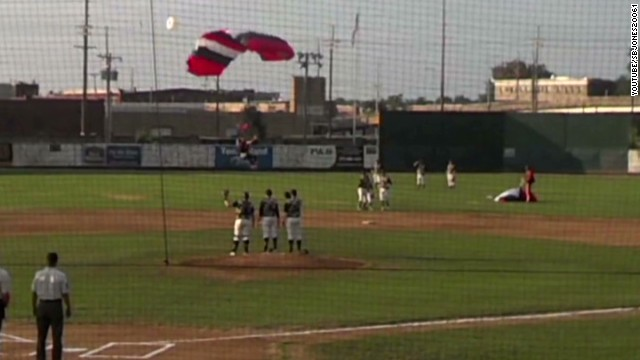 Sky diver kicks baseball player in face