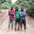 invisible borders Emeka, Jide and Emmanuel in the mud, Ekok Road, Cameroun