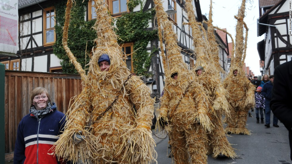 In Whittlesea, England, there was once a tradition on the first Tuesday after Plough Monday to dress a local farmer in a costume made of hay and parade him around the street. The tradition ended in 1909, but was revised in 1980. In 1999, The English 'straw bear' made friends with its German counterpart (pictured).