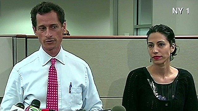 Weiner apologizes with wife at his side
