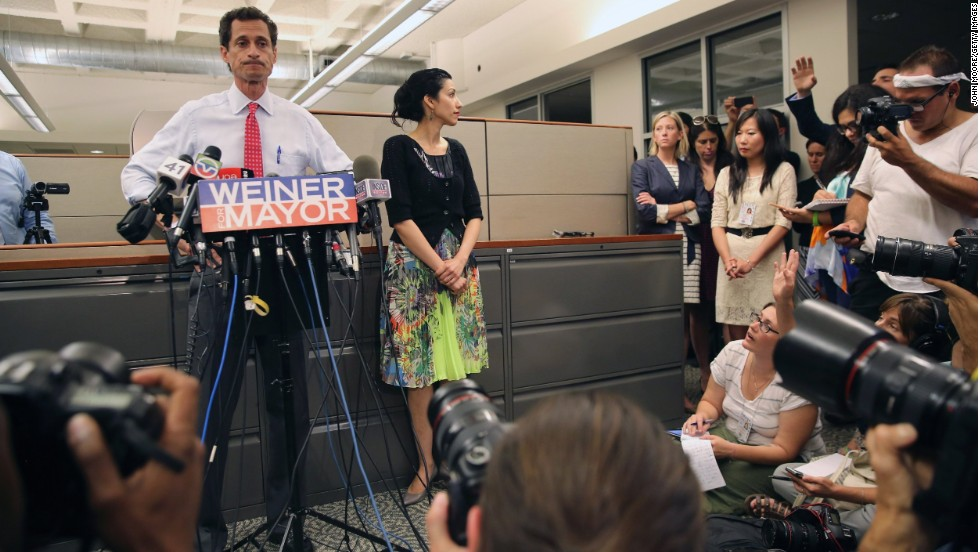 Huma Abedin stood beside her husband, Anthony Weiner, on Tuesday, July 23, as he once again addressed issues surrounding sending explicit messages over the Internet.  At times she smiled, other times she appeared solemn, but her message was clear: She is standing by her husband.  Abedin has worked for former Secretary of State Hillary Clinton for more than a decade, and while she's known for shying away from the spotlight, she can often be seen just offstage.