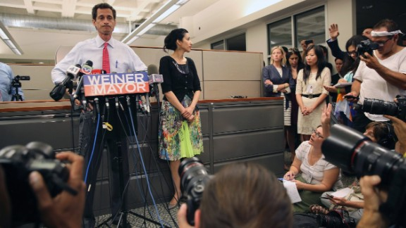 Huma Abedin stood beside her husband, Anthony Weiner, on Tuesday, July 23, as he once again addressed issues surrounding sending explicit messages over the Internet.  At times she smiled, other times she appeared solemn, but her message was clear: She is standing by her husband.  Abedin has worked for former Secretary of State Hillary Clinton for more than a decade, and while she