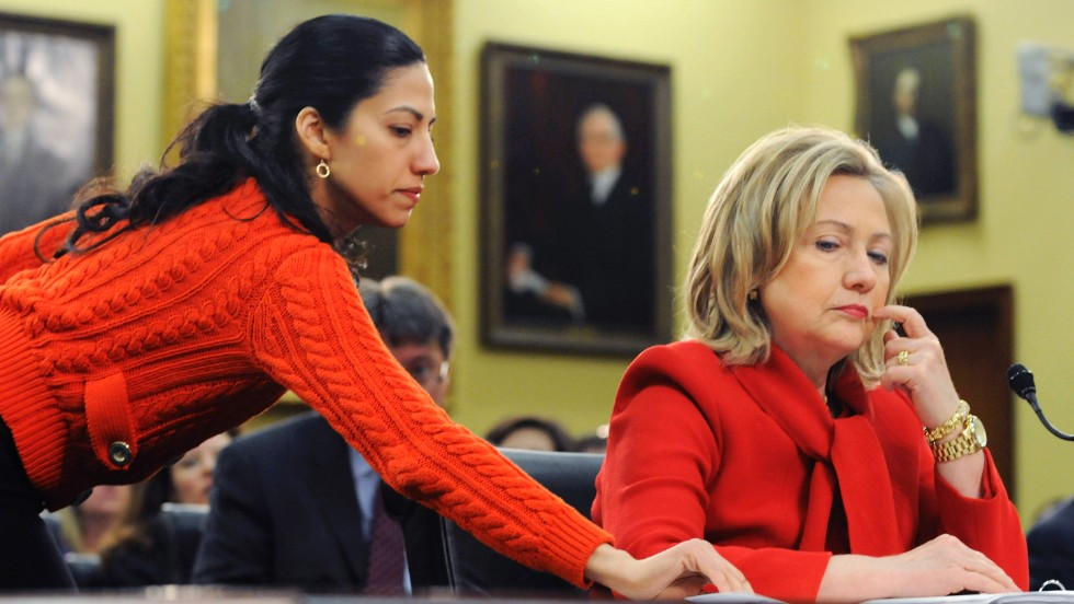 Abedin delivers a note to Clinton on March 10, 2011, during a hearing of the House State, Foreign Operations and Related Programs Subcommittee. She started as a White House intern in 1996.