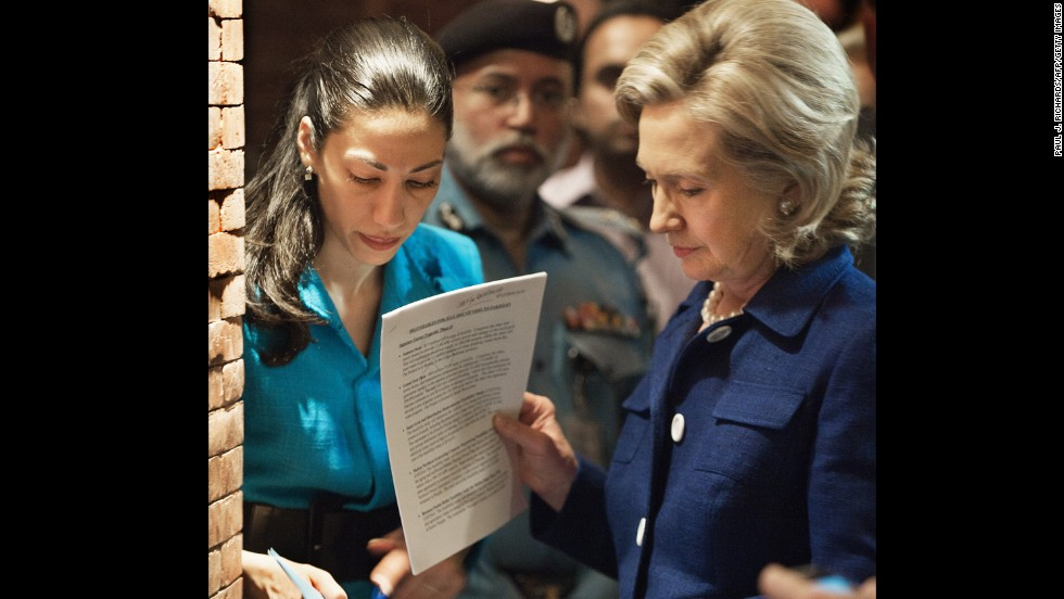 Abedin, Clinton's deputy chief of staff, helps prep Clinton with speech notes on July 19, 2010, before an interview on Pakistani TV in Islamabad.