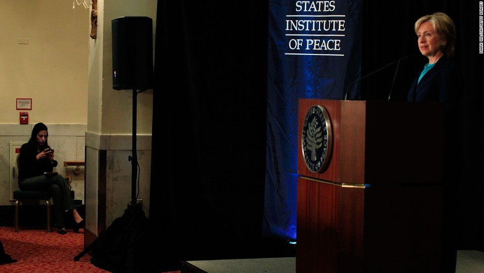 Abedin sits offstage as Clinton speaks on reinvigorating the United States' nonproliferation policy on October 21, 2009, at the Mayflower Hotel in Washington.