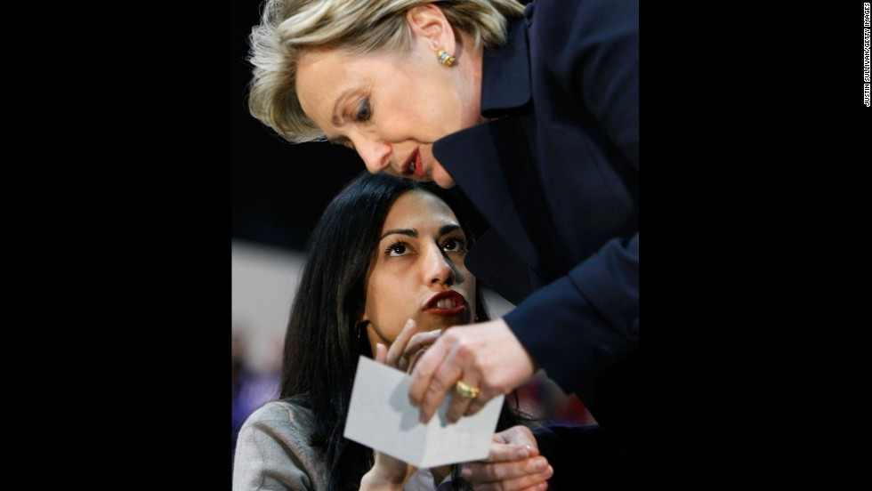 Abedin, a campaign staffer at the time, talks with then-Sen. Clinton before a rally in Los Angeles on February 2, 2008.