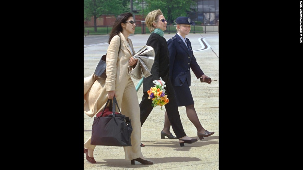 Serving as Clinton's personal aide, Abedin accompanies Clinton on a trip from New York  to Andrews Air Force Base in Maryland on May 6, 2000, to meet with President Bill Clinton.