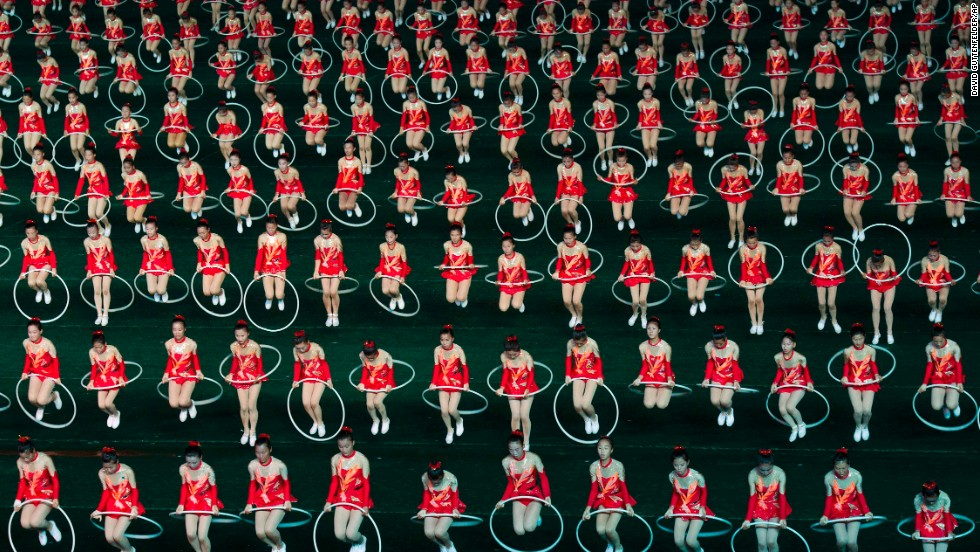 "Women jump through hula hoops during the opening night of the annual Arirang Festival, or ""mass games,"" at Pyongyang's May Day Stadium on Monday, July 22."