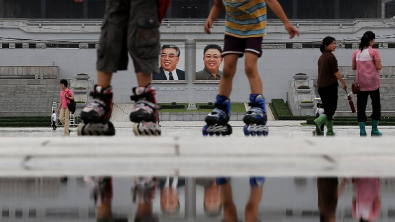 Children skate around the Kim Il Sung Square on July 21 in downtown Pyongyang.