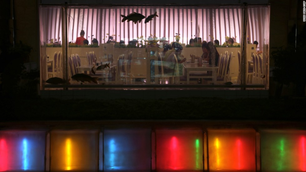 People dine in a restaurant at the Koryo hotel on July 21 in downtown Pyongyang.