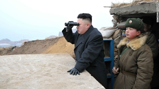 "This picture, taken by North Korea's official Korean Central News Agency on March 7, 2013 shows North Korean leader Kim Jong Un (C) using a pair of binocular to look south as he inspects Jangjae Islet Defence Detachment near South Korea's Taeyonphyong Island in South Hwanghae province, North Korea's southwestern sector of the front.   AFP PHOTO / KCNA via KNS ---EDITORS NOTE--- RESTRICTED TO EDITORIAL USE - MANDATORY CREDIT ""AFP PHOTO / KCNA VIA KNS"" - NO MARKETING NO ADVERTISING CAMPAIGNS - DISTRIBUTED AS A SERVICE TO CLIENTS        (Photo credit should read KNS/AFP/Getty Images)"