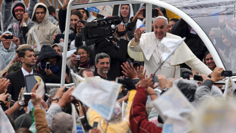 Pope Francis waves to pilgrims as he arrives at the Basilica of Our Lady of Aparecida on July 24.