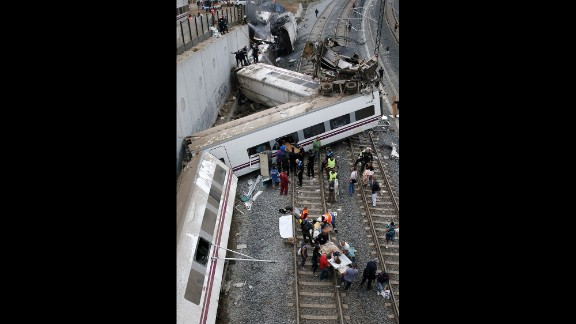 The state railway company said the train derailed on a curve as it was approaching the train station in Santiago de Compostela.