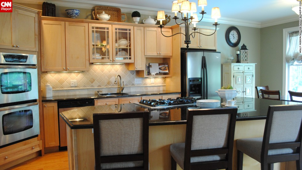 "<a href=""http://ireport.cnn.com/docs/DOC-1009299"">Holly Modica</a>, from Middletown, Connecticut, said not using the space above your cabinets to <a href=""http://housebyholly.blogspot.com/2012/06/the-heart-of-home.html "" target=""_blank"">display the things you love</a> is a ""missed decorating opportunity."""