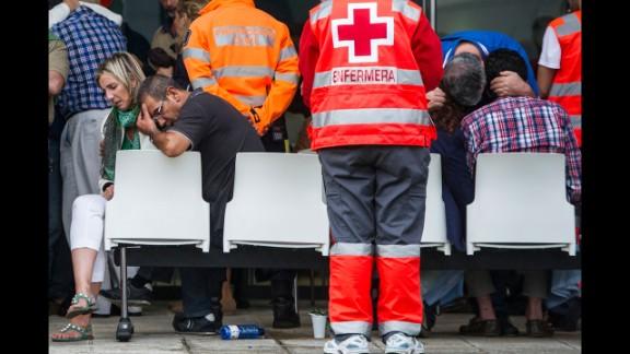 Other relatives of passengers wait for information in Santiago de Compostela on July 25.