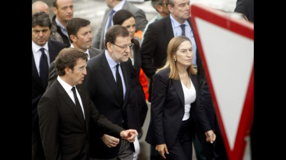 Spanish Prime Minister Mariano Rajoy, center, visits the crash site July 25 with Public Works Minister Ana Pastor, right, and Alberto Nunez Feijoo, head of the regional government in Galicia. The latter declared seven days of mourning for victims of the crash.