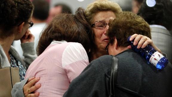 Women wait for news about crash victims in Santiago de Compostela on July 25.